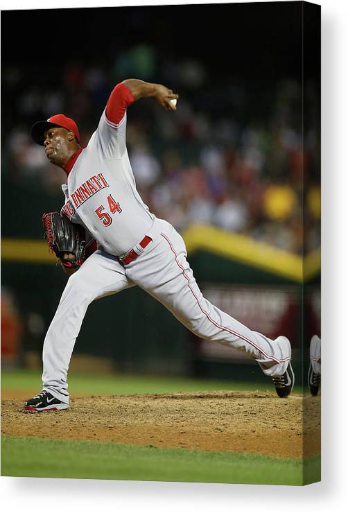 Relief Pitcher Canvas Print featuring the photograph Aroldis Chapman by Christian Petersen