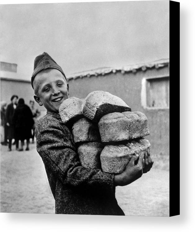 History Canvas Print featuring the photograph Polish Youngster With Bread Made by Everett