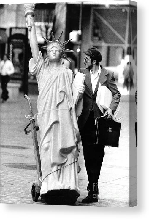 1980-1989 Canvas Print featuring the photograph A Model Of Lady Liberty Was Being Sold by New York Daily News Archive