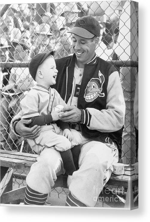 American League Baseball Canvas Print featuring the photograph Bob Feller With Young Fan by Transcendental Graphics