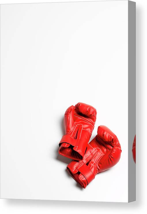 The End Canvas Print featuring the photograph Boxing Gloves On White Background by Peter Dazeley