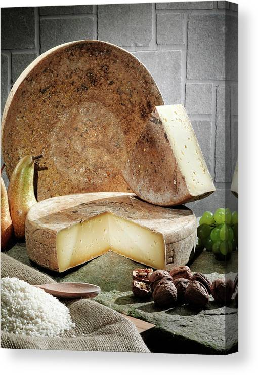Fontina Canvas Print featuring the photograph Cheese, Fruit And Grains On Table by Walter Zerla