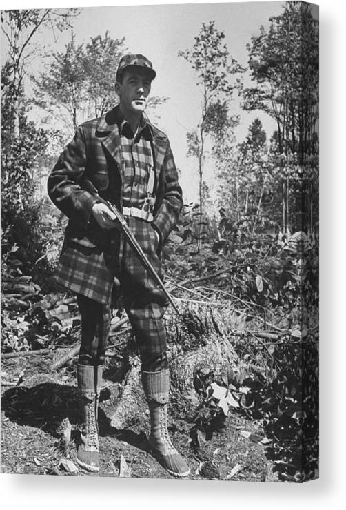 Timeincown Canvas Print featuring the photograph Man In Deer Hunting Outfit In Red & Blac by George Strock