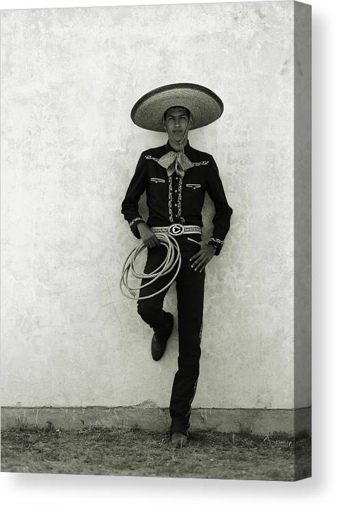 Cool Attitude Canvas Print featuring the photograph Mexican Cowboy Wearing Hat And Holding by Terry Vine