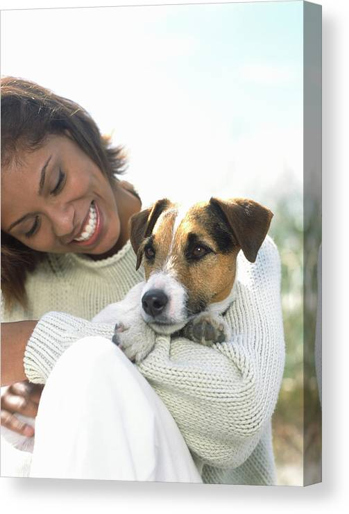 Pets Canvas Print featuring the photograph Young Woman Holding Jack Russell by Todd Pearson