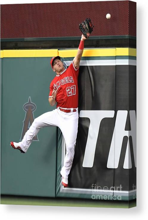 Second Inning Canvas Print featuring the photograph Brandon Belt and Mike Trout by John Mccoy