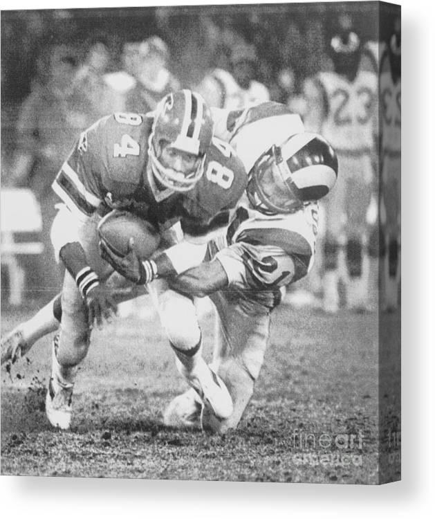 American Football Uniform Canvas Print featuring the photograph Football Player Alfred Jenkins Brings by Bettmann