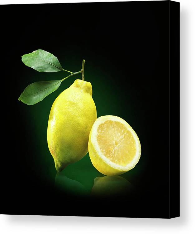 Black Background Canvas Print featuring the photograph Lemon Slice by Jeremy Hudson