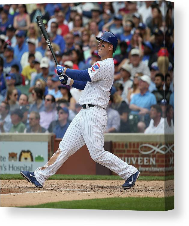 Following Canvas Print featuring the photograph Anthony Rizzo by Jonathan Daniel