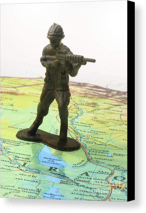 Aggression Canvas Print featuring the photograph Toy Solider On Iraq Map by Amy Cicconi