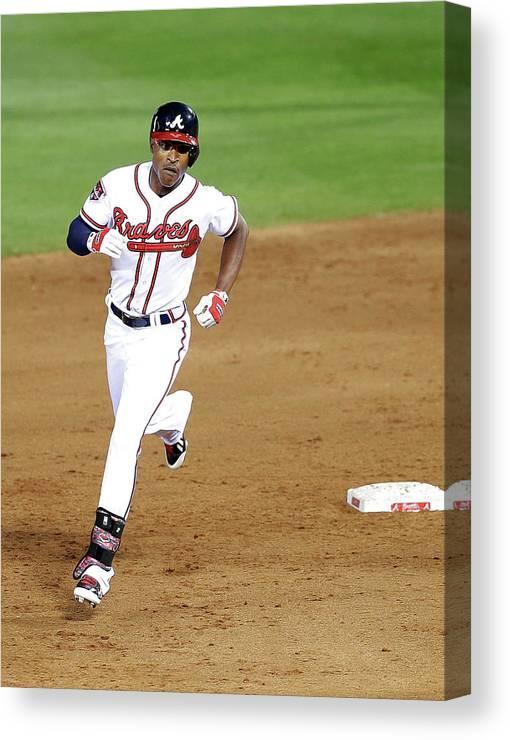 Atlanta Canvas Print featuring the photograph Milwaukee Brewers V Atlanta Braves by Mike Zarrilli