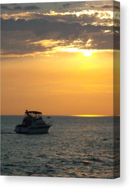 Boater On Lake Michigan Canvas Print featuring the photograph I'll Follow The Sun by Sylvia Herrington