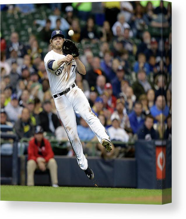 Ball Canvas Print featuring the photograph Jordy Mercer And Mark Reynolds by Jeffrey Phelps