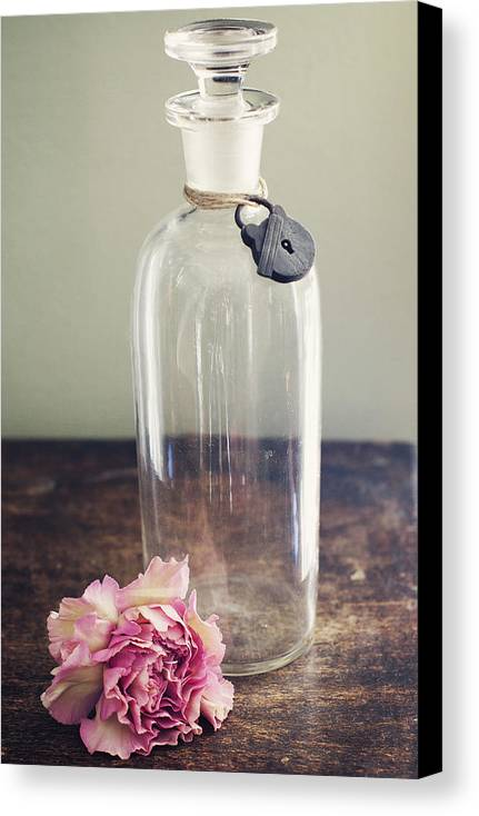 Flower Canvas Print featuring the photograph Pink Carnation Blossom And Vintage Glass Bottle by Di Kerpan