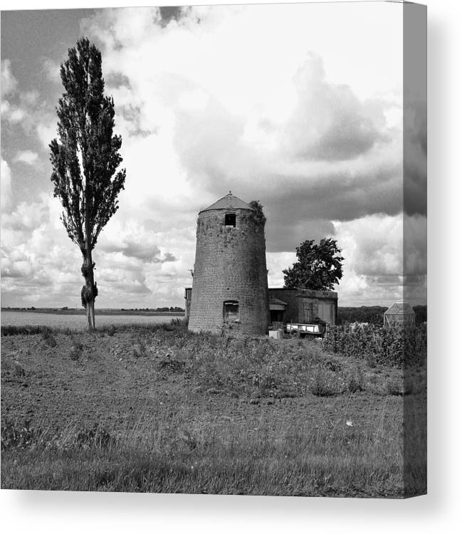 Old Silo Canvas Print featuring the photograph Dust In The Wind by Joe Martin