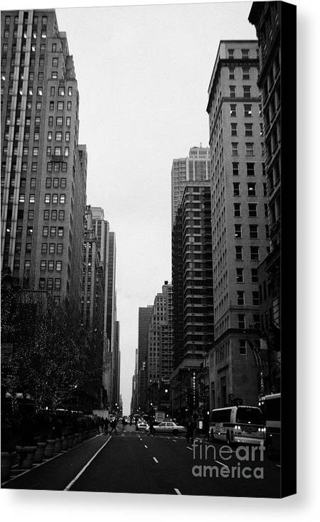 Usa Canvas Print featuring the photograph View Up 6th Ave Avenue Of The Americas From Herald Square In The Evening New York City Winter by Joe Fox