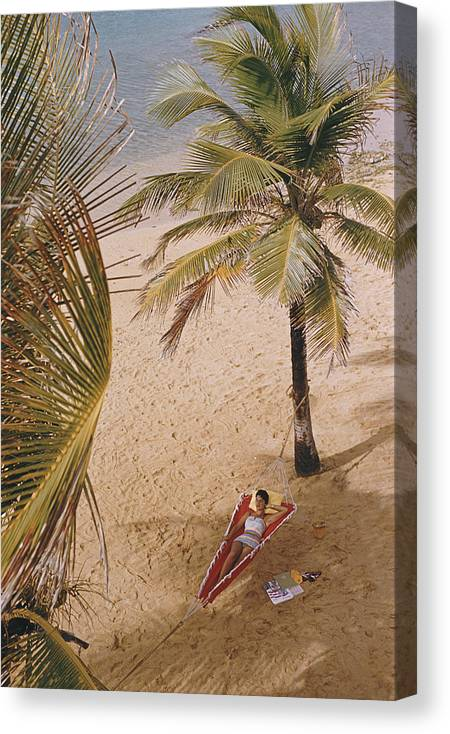 Tranquility Canvas Print featuring the photograph Caribe Hilton Beach by Slim Aarons