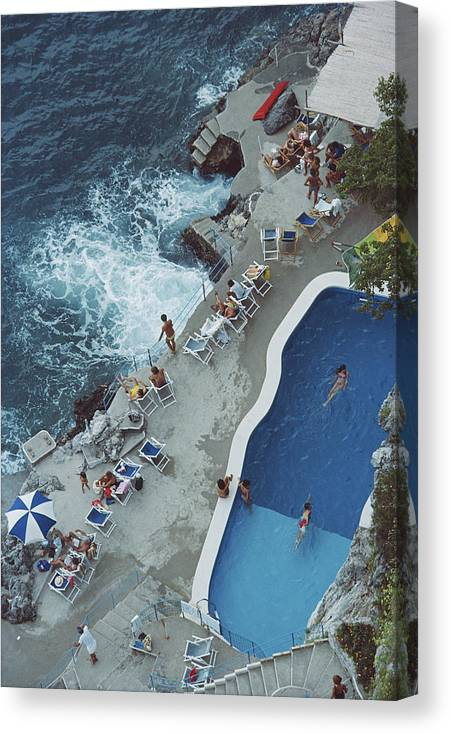 1980-1989 Canvas Print featuring the photograph Pool On Amalfi Coast by Slim Aarons