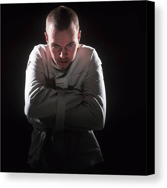 Strait Jacket Canvas Print featuring the photograph Psychiatric Patient by Kevin Curtis