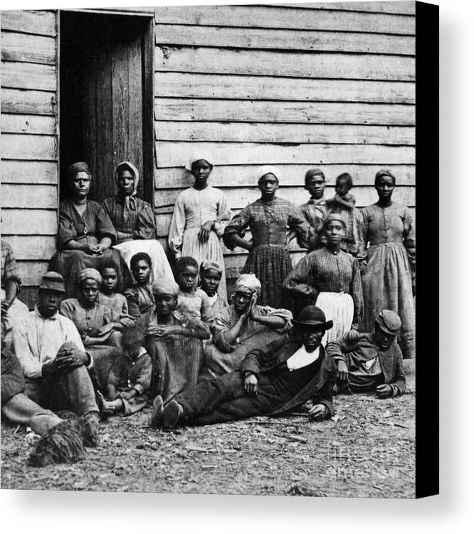 Slavery Canvas Print featuring the photograph A Group Of Slaves by Photo Researchers