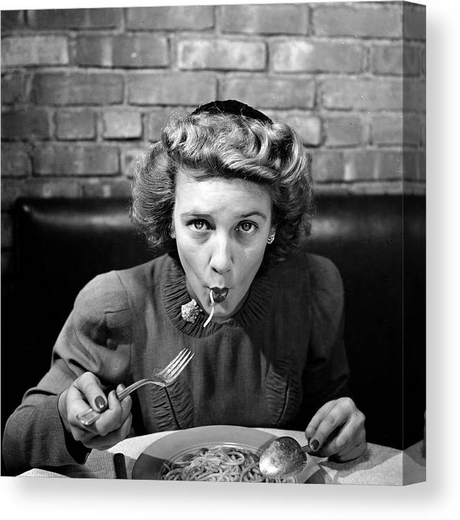 Timeincown Canvas Print featuring the photograph Woman Eating Spaghetti In Restaurant 5 by Alfred Eisenstaedt