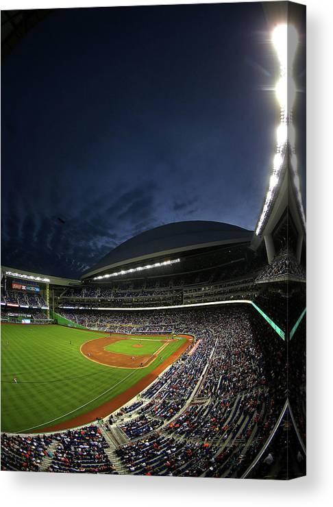 American League Baseball Canvas Print featuring the photograph Colorado Rockies V Miami Marlins by Mike Ehrmann