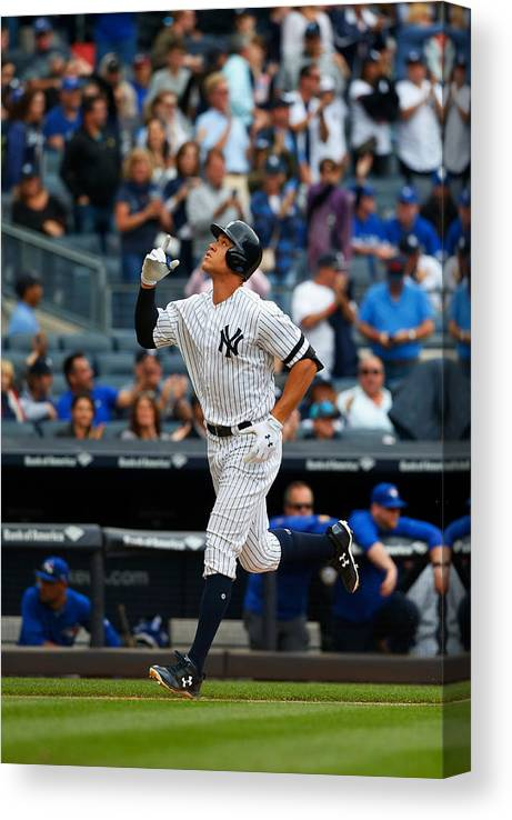 People Canvas Print featuring the photograph Toronto Blue Jays v New York Yankees by Jim McIsaac