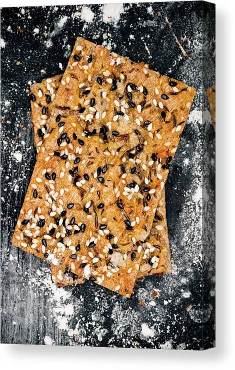Sweden Canvas Print featuring the photograph Crispbread With Thyme On Metal Sheet by Johner Images