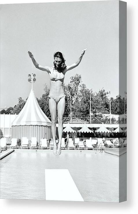 Personality Canvas Print featuring the photograph Donna Garrett Jumping On Diving Board by William Connors