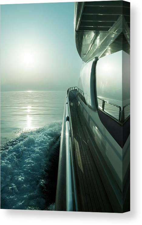Desaturated Canvas Print featuring the photograph Luxury Motor Yacht Sailing At Sunset by Petreplesea