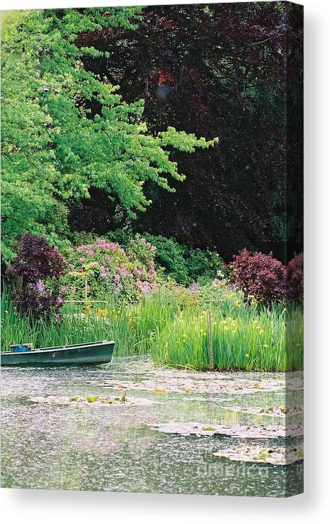Monet Canvas Print featuring the photograph Monet's Garden Pond And Boat by Nadine Rippelmeyer