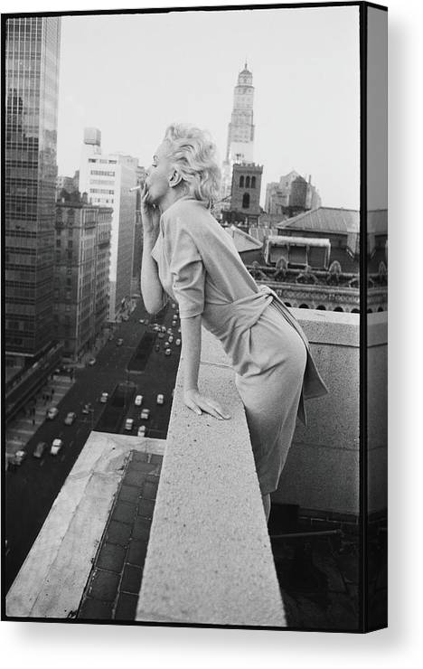 Smoking Canvas Print featuring the photograph Marilyn On The Roof by Michael Ochs Archives