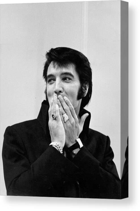 Elvis Presley Canvas Print featuring the photograph Rock And Roll Musician Elvis Presley by Michael Ochs Archives