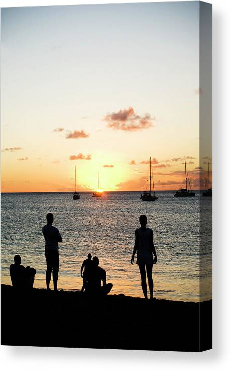 Recreational Pursuit Canvas Print featuring the photograph Group Of Young Friends On Beach At by Jaminwell