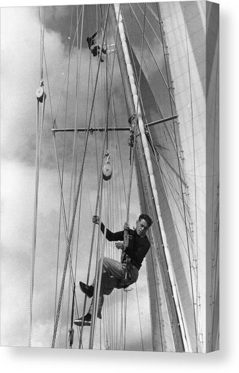Hanging Canvas Print featuring the photograph Hoisted Aloft by Bert Hardy
