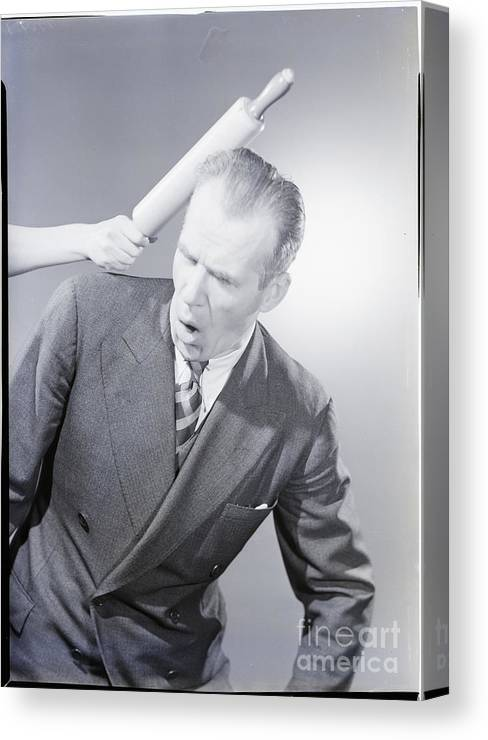 People Canvas Print featuring the photograph Husband Being Hit With Rolling Pin by Bettmann