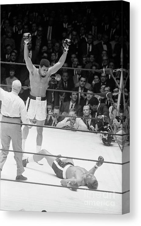 Human Arm Canvas Print featuring the photograph Muhammad Ali Knocks Out Cleveland by Bettmann