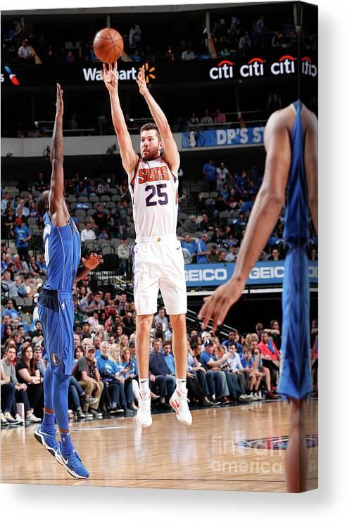 Sports Ball Canvas Print featuring the photograph Phoenix Suns V Dallas Mavericks by Danny Bollinger