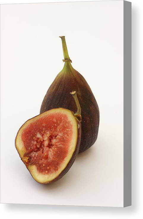 White Background Canvas Print featuring the photograph Ripe, Fresh Figs On White Background by Rosemary Calvert