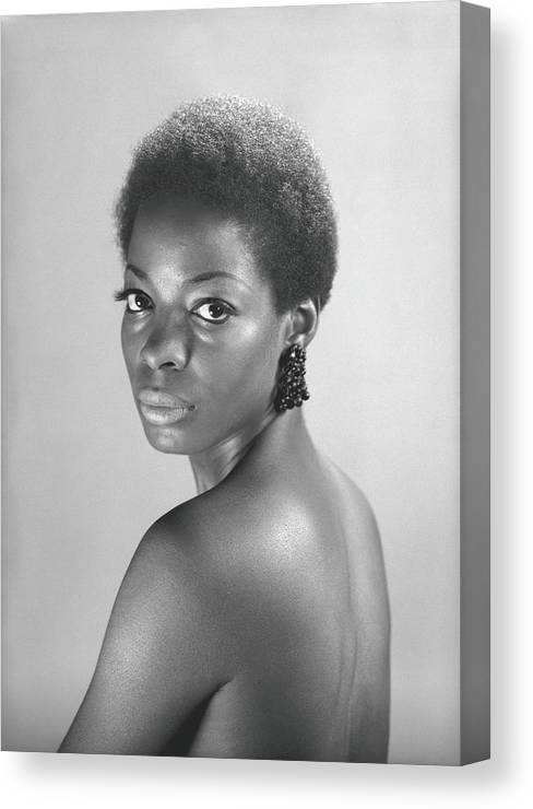 Looking Over Shoulder Canvas Print featuring the photograph Semi Dress Woman Posing In Studio, B&w by George Marks