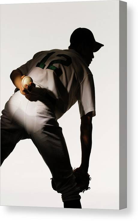 Three Quarter Length Canvas Print featuring the photograph Silhouette Of Baseball Pitcher Holding by Pm Images