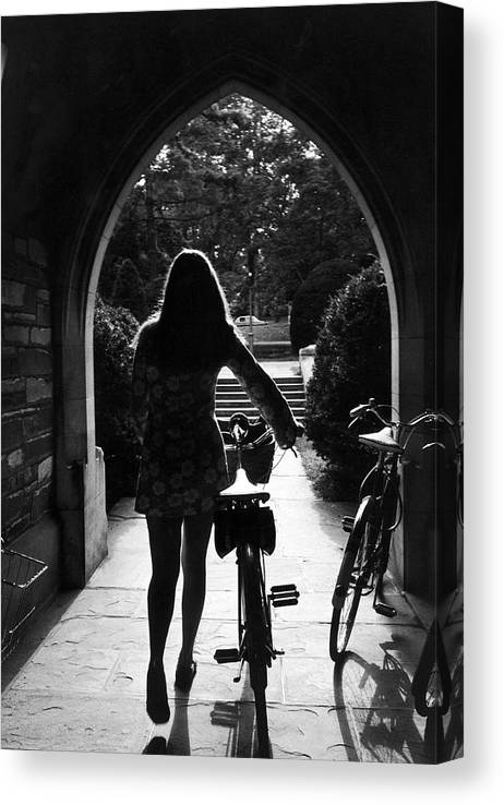 Arch Canvas Print featuring the photograph Silhouette Of College Co-ed Walking Her by Alfred Eisenstaedt