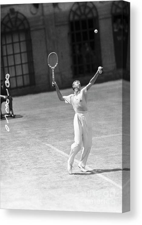 Playoffs Canvas Print featuring the photograph Tennis Player Don Budge Serving Tennis by Bettmann