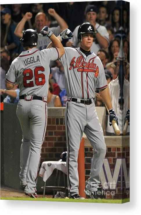 People Canvas Print featuring the photograph Dan Uggla and Chipper Jones by David Banks