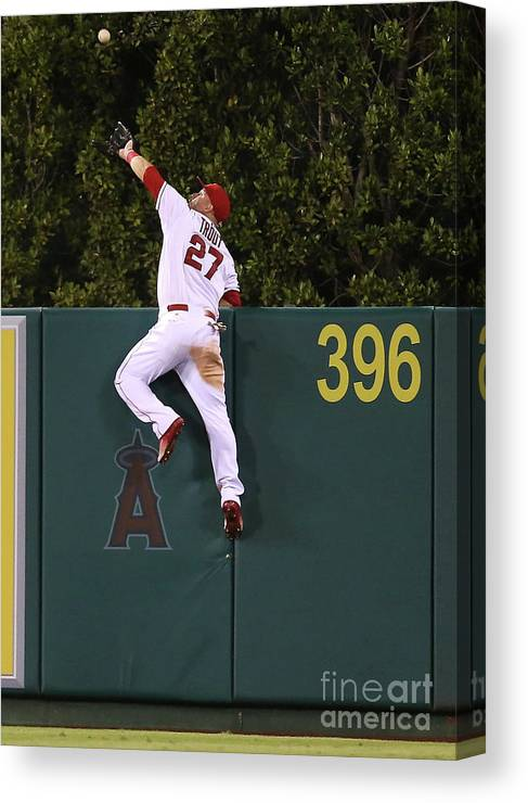People Canvas Print featuring the photograph Jesus Montero and Mike Trout by Stephen Dunn