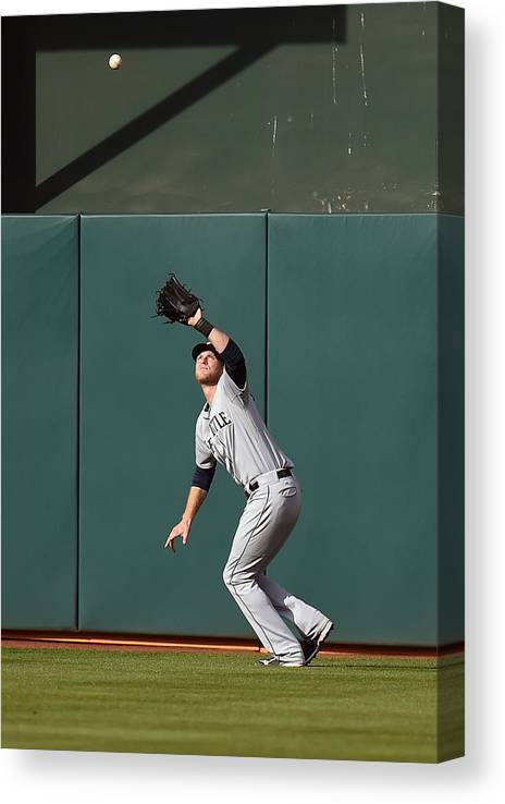 Game Two Canvas Print featuring the photograph Michael Saunders and Craig Gentry by Thearon W. Henderson