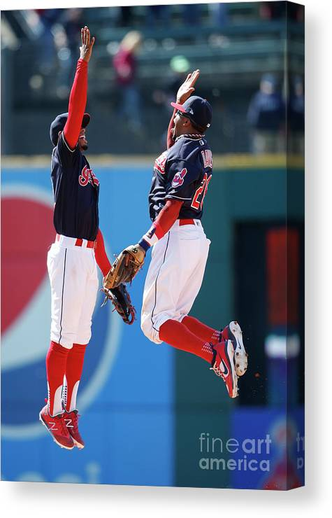 People Canvas Print featuring the photograph Rajai Davis and Francisco Lindor by Ron Schwane