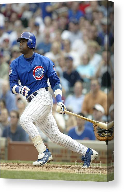 Motion Canvas Print featuring the photograph Sammy Sosa by Ron Vesely