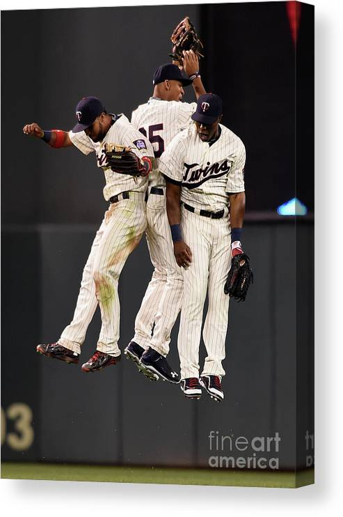 People Canvas Print featuring the photograph Torii Hunter, Byron Buxton, and Eddie Rosario by Hannah Foslien