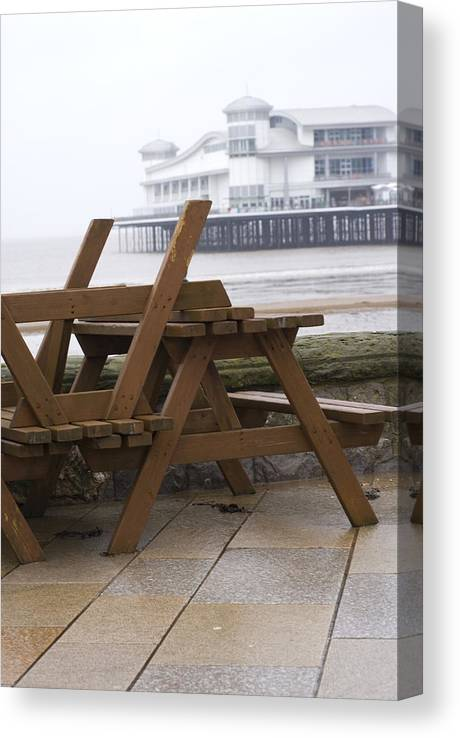 Weston-super-mare Canvas Print featuring the photograph Upturned wooden tables at out of season seaside by Lyn Holly Coorg